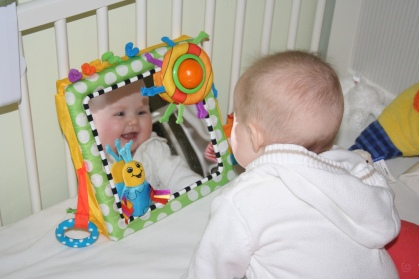 Smiling at the baby in the mirror by Christopher Blizzard. Flickr. (CC BY-SA 2.0)